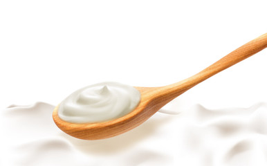 Wooden spoon with sour cream on blank