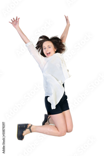 Young joyful woman in a jump