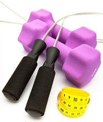 Skipping rope, measuring tape and and Pink dumbbells