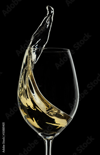 White wine splash on black background
