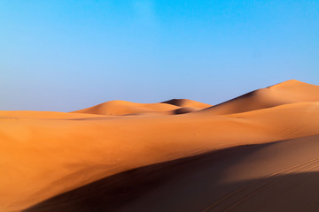 Arabian desert dune background on blue sky