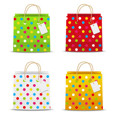 Set of color shopping bags with dots pattern