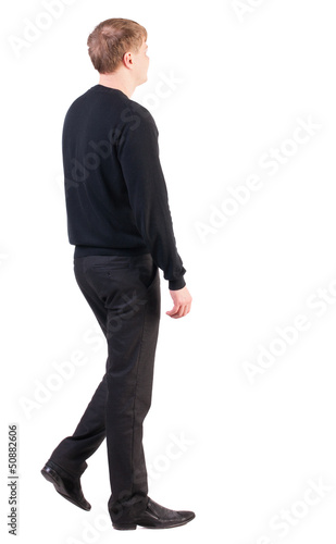back view of walking  business man