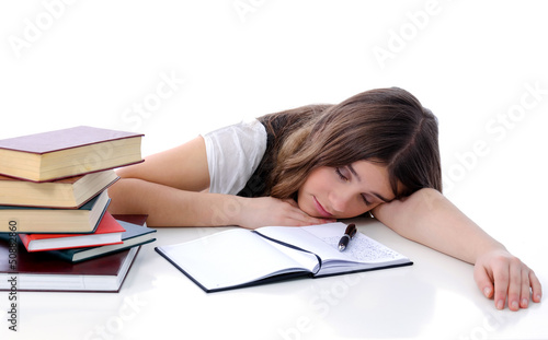 Tired teenager sleeping after learning