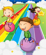 Three kids playing with the bouncing balls at the colorful road