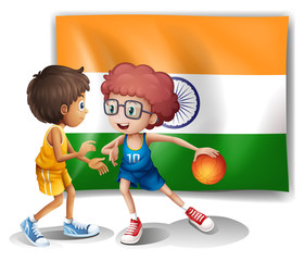 Two boys playing basketball in front of the Indian flag
