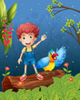 A boy with a bird at the forest