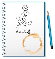 A notebook with a sketch of a person surfing