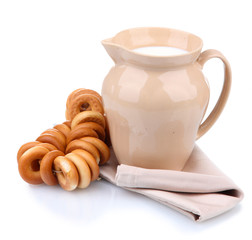 jar of milk, tasty bagels, isolated on white