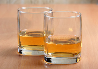Whiskey glasses on wood