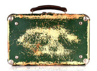 Old green shabby suitcase