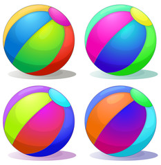 Four colorful inflatable balls