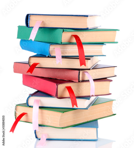 Many books with bookmarks isolated on white