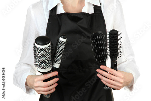 Hairdresser in uniform with working tools, isolated on white