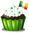 A chocolate cupcake with clover plants and the flag of Ireland