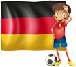 A boy with a soccer ball in front of the flag of Germany
