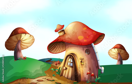 Staande foto Magische wereld A mushroom house at the top of the hill