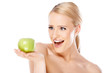 Happy and healthy woman holding apple