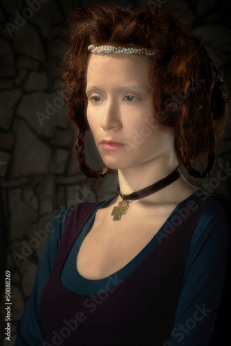 Portrait of redhead woman stylized as old picture