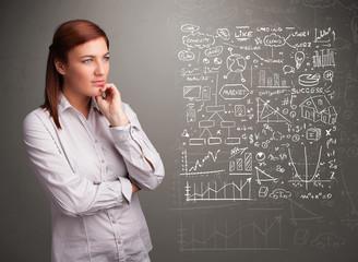 Pretty woman looking at stock market graphs and symbols