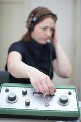 ear exam with headphones