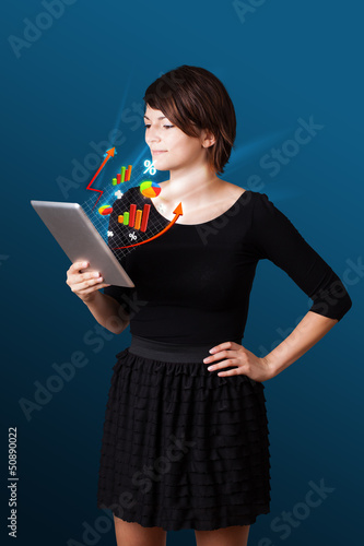 Young woman looking at modern tablet with abstract lights and va