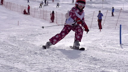 Seven-year girl participates in downhill skiing