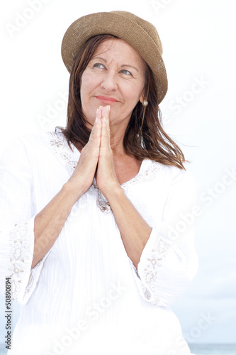 Relaxed mature woman happy praying outdoor