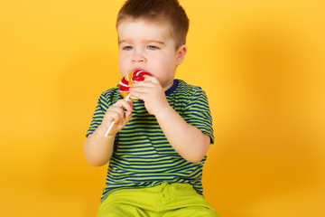 Little baby boy with motleyl candy