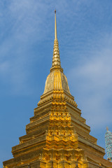 Golden pagoda with blue sky.