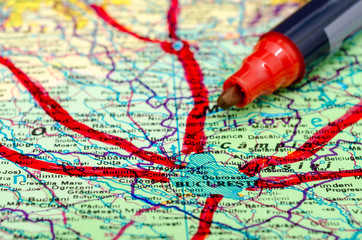 Marking The Vacation Trips On Map With Red Marker