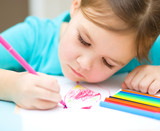 Cute cheerful child drawing using felt-tip pen