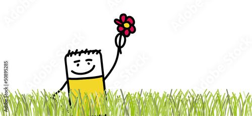 Personnage dans la nature qui montre une fleur