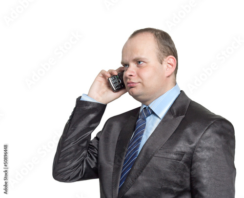 Businessman talking on a mobile phone isolated