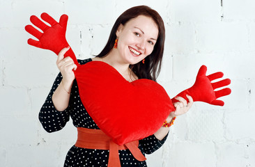 Woman with red heart toy