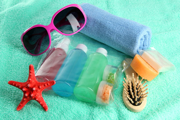 Hotel cosmetics kit on blue towel