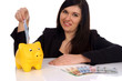 Woman with piggy bank and euro banknotes