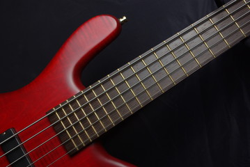 Bass guitar with red body
