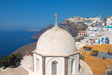 Church in Fira with Imerovigli in the back