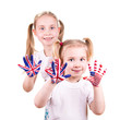 American and English flags on child's hands.