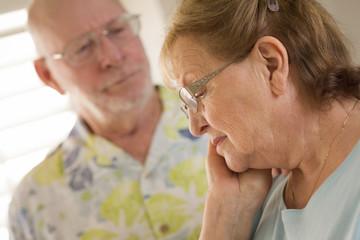 Senior Adult Male Consoles Sad Senior Adult Female
