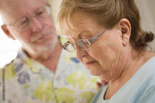 Senior Adult Male Consoles Sad Senior Adult Female