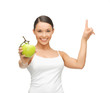 woman with green apple pointing her finger up