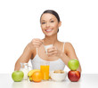 young woman eating healthy breakfast