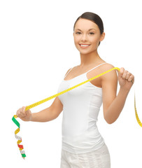 sporty woman with measuring tape