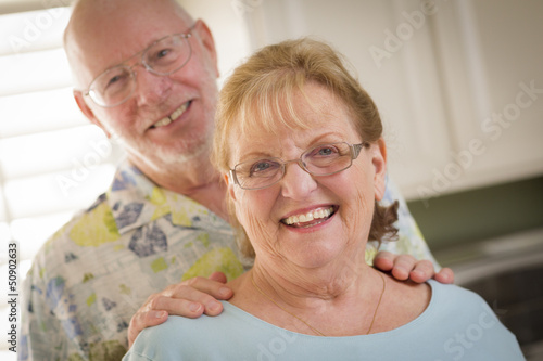 Happy Caucasian Senior Couple Portrait Inside