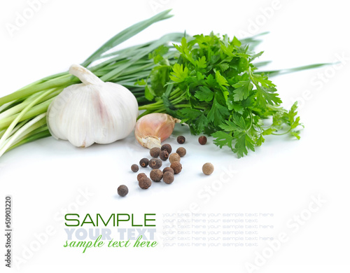 Grains of pepper are with a garlic and greenery of parsley