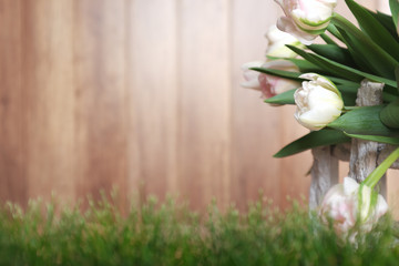 White tulips with rustic wood background