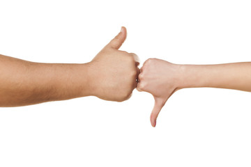male and female hand showing thumbs like and dislike on white