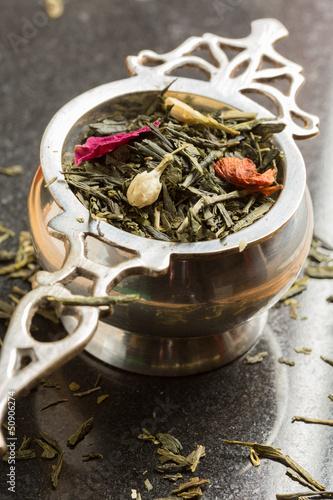 Green tea in tea strainer